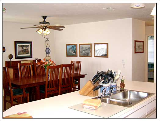 The dining room is visible from the kitchen too.