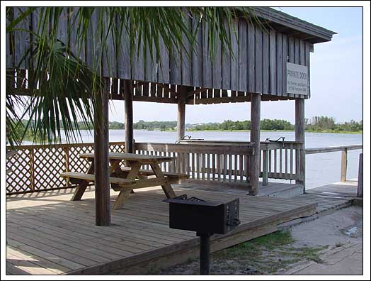 Fish cleaning station and barbeque area at fishing dock.